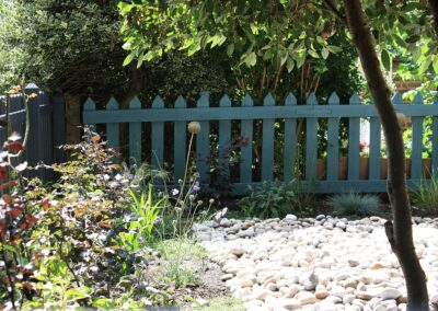 Blue picket fence with calendonian cobbles